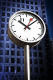 Clock at Canary Wharf. One of the iconic Clocks of Canary Wharf .Canary Wharf Tower is in the background royalty free stock photography