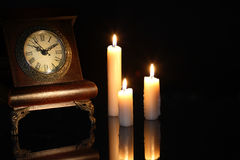 Clock And Candles Royalty Free Stock Photos