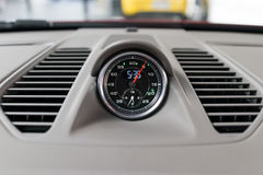 Clock in car. A clock on the dashboard of a car Royalty Free Stock Photo