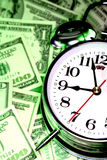Clock & cash Stock Photos
