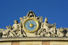 Clock of the castle of Versailles. Versailles castle clock lying in the marble courtyard above the King's Chamber sun, Louis XIV Royalty Free Stock Photography