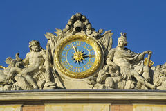 Clock of the castle of Versailles. Versailles castle clock lying in the marble courtyard above the King's Chamber sun, Louis XIV Stock Photo