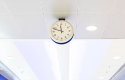 Clock on ceiling at airport Royalty Free Stock Photos