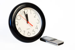 Clock&cell phone. Waiting for a call - time, stress or rush business concept royalty free stock photos
