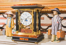 Clock and ceramic dolls. Old fashion clock and ceramic dolls close-up Royalty Free Stock Photography