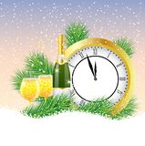 Clock and champagne with the branches of fir-tree on to snow Stock Photo