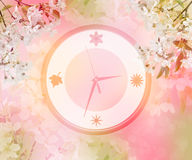 Clock in cherry blossoms. Spring comes. Concept Stock Images