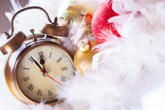 Clock and christmas balls - holiday background Stock Images
