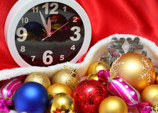 Clock and christmas balls and toys Stock Image