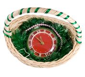 Clock in Christmas Basket. Last five minutes to Christmas. The clock in Christmas Basket on a white background Stock Photography