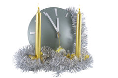 Clock  with christmas  decoration over white Royalty Free Stock Images