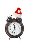 Clock with christmas hat Royalty Free Stock Photography