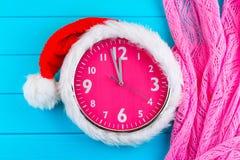 Clock with christmas santa hat Royalty Free Stock Photo