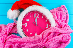 Clock with christmas santa hat Royalty Free Stock Images