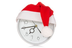 Clock with christmas santa hat Stock Photo