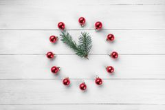 Clock in the Christmas style, round frame, Christmas festive. Background. Christmas theme, composition. Top view, place for text, flat lay. Christmas and happy stock photo
