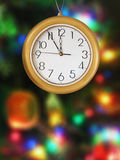 Clock and christmas tree Stock Photos