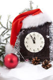 Clock in christmass hat with fur-tree Stock Images