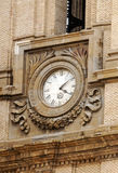 Clock of a church in gothic  style. Clock of a church in gothic style, located in the Spanish city of Zaragoza, it´s a vertical picture Stock Photos