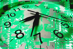 Clock and Circuit Board Royalty Free Stock Photography
