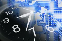 Clock and Circuit Board Royalty Free Stock Images
