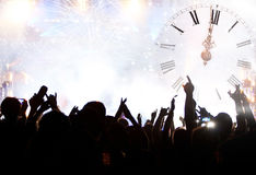 Clock close to midnight, fireworks and crowd waiting for New yea Royalty Free Stock Image