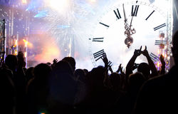 Clock close to midnight, fireworks and crowd waiting for New yea Stock Image