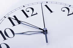 Clock. Close up of clock face on white background Stock Photography