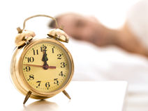 Clock close up, person sleeping in the background Stock Photography
