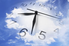 Clock and Cloudy Sky. Composite of Clock and Cloudy Sky Stock Photo