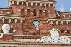 Clock and coat of arms on the railway station in Kazan. Stock Photos