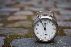 Clock on a cobblestone Royalty Free Stock Photos