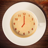Clock on coffee Royalty Free Stock Image