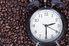 Clock and coffee beans Coffee time concept Royalty Free Stock Photos