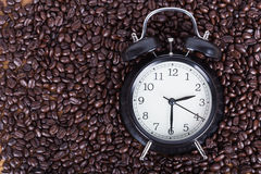Clock and coffee beans Coffee time concept Royalty Free Stock Image