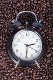 Clock and coffee beans Coffee time concept Royalty Free Stock Photo
