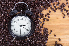 Clock and coffee beans Coffee time concept Royalty Free Stock Images