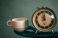 Clock and coffee cup Stock Images