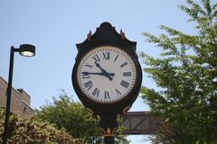 Clock on College Campus. A clock in the school yard of a college or university campus Royalty Free Stock Image