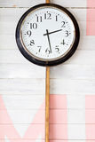 Clock on color wooden Royalty Free Stock Photos