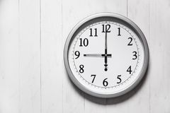 Clock on color wooden plank wall. 9 o`clock stock images