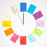 Clock of colored envelopes for Christmas mailing. Twelve envelopes isolated on white background. Clock of colored envelopes for Christmas mailing Stock Images