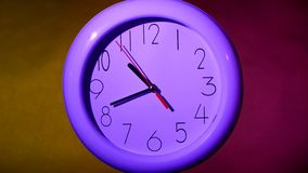 Clock on colorful background. White office clock on colorful background with clipping path. At 10:35 times stock video