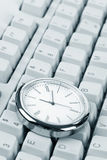 Clock and computer Keyboard Stock Image