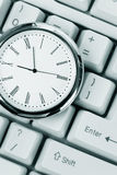 Clock and computer Keyboard Stock Photos