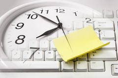 Clock and Computer Keyboard Royalty Free Stock Photography
