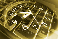 Clock and Computer Keyboard Stock Photography