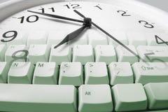 Clock and Computer Keyboard Royalty Free Stock Image