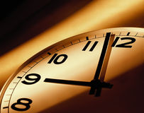 Clock Conceptual. Time flies conceptual with warm color rays Royalty Free Stock Photo