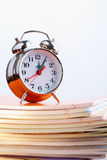 Clock and copybooks Stock Photo